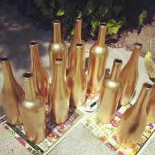 Wine bottles spray painted in gold